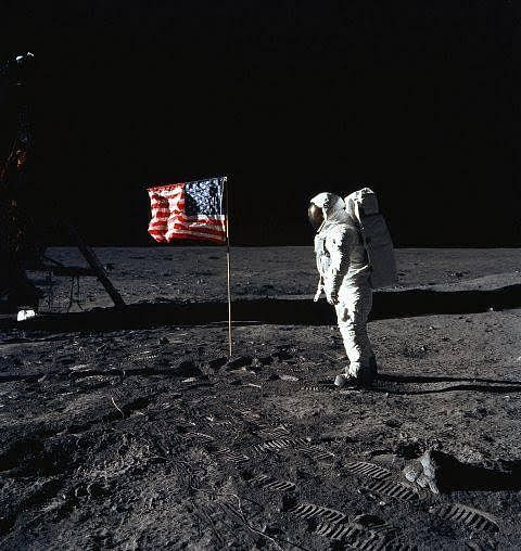 Astronaut Edwin E. Aldrin, Jr., lunar module pilot of the first lunar landing mission, poses for a photograph beside the deployed United States flag on the lunar surface area called the Sea of Tranquility in this 20 July, 1969, file photo. This 16 July, 2004, NASA celebrates the 35th anniversary of the start of the historic mission of Apollo 11. AFP PHOTO / NASAn(Photo credit should read HO/AFP/Getty Images)nDCX06